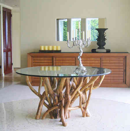 Tangle roots under a glass top. Dining or conference table.