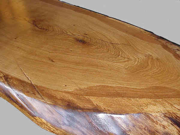 Annual rings of oak, an oval coffee table with natural edgings.