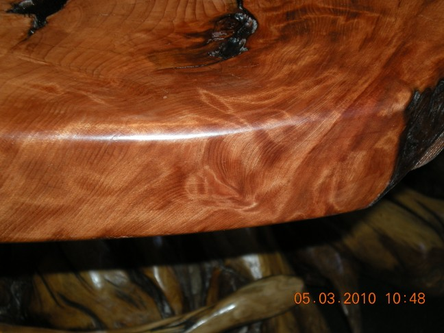 Roundover edging exposes the burl graining.